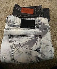 two black and gray denim bottoms