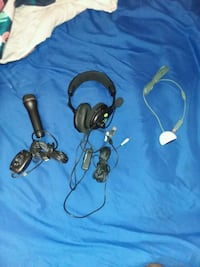 two black and blue corded headphones Passaic, 07055
