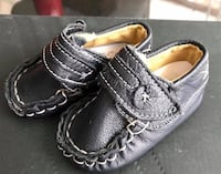 pair of baby's black leather shoes