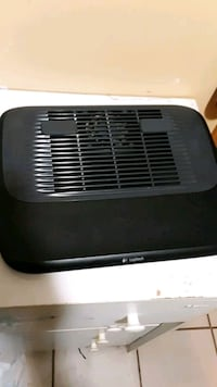 Laptop cooling fan with speed selection .