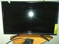 black flat screen TV with remote Fayetteville, 28314