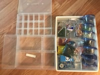 There are various sizes of beads and stones with 3 boxes
