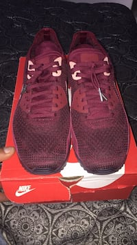 pair of red Nike running shoes on box Boise, 83709