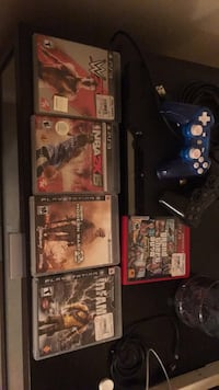 Sony PS3 slim console with controller and game cases Tallahassee, 32301