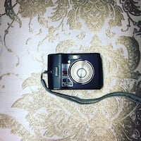 black Canon point-and-shoot camera 1960 km