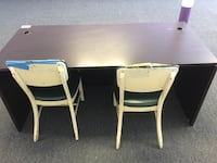 rectangular white wooden table with four chairs