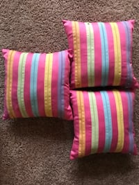 three square pink-yellow-orange-and-blue striped throw pillows