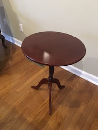 round brown wooden pedestal table 365 mi