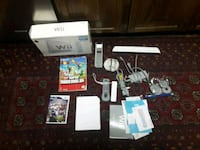 Nintendo Wii console with controller and game cases Burke