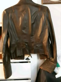 Brown leather jacket that does up with hooks.  Windsor, N8S 1N6