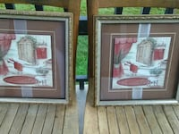 two bathtub with red towel paintings with brown wooden frames