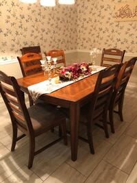 Rectangular brown solid wood table with 6 chairs dining set Shreveport, 71115