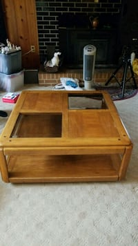 brown wooden framed glass top coffee table Centreville, 20121
