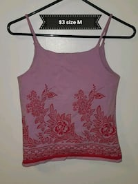 size M pink and red floral spaghetti strap top with text overlay