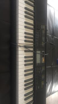 black and white Casio electronic keyboard