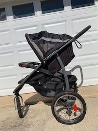 Black and gray tandem stroller