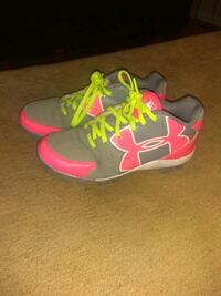 pair of grey and-pink Under Armour cleats Brigantine, 08203