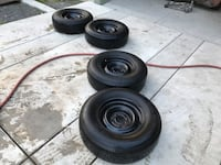 235-75-15. 5 on 5 gm 2 wheel drive pickup wheels ad tires with some life left on tires.
