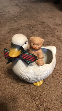 White and brown duck with bear ceramic figurine