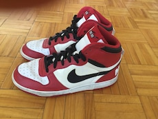 pair of black-red-and-white Nike sneakers high