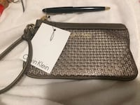 brown Calvin Klein leather wristlet