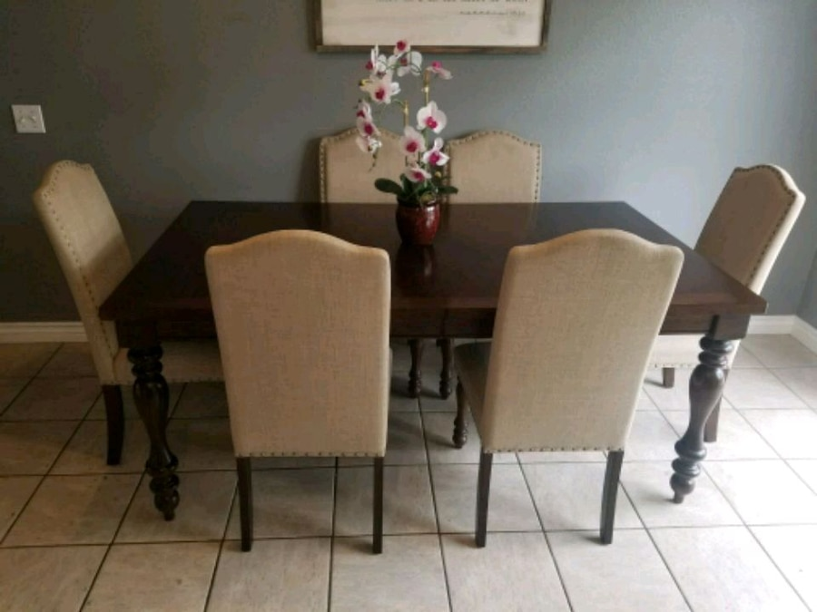 brown wooden table with four chairs dining set for sale  Perris