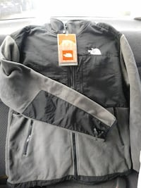 black and gray The North Face zip-up jacket