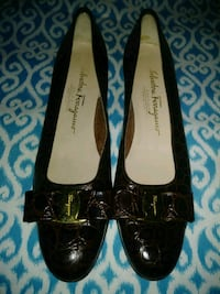 pair of black leather pointed-toe flats 2296 mi