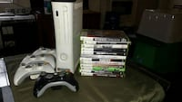 white Xbox 360 game console with two game controllers and assorted game cases Centreville, 20121