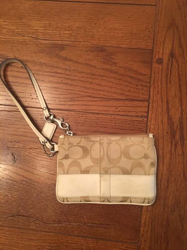 Brown monogrammed Coach leather wristlet