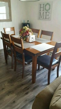 rectangular brown wooden table with six chairs din Perris