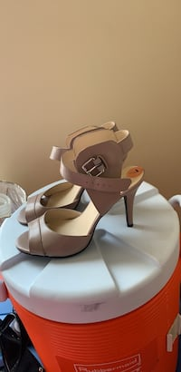 pair of white leather open toe ankle strap heels