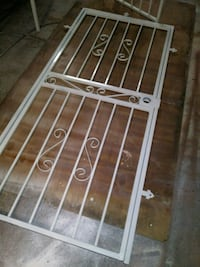 white metal frame glass panel door