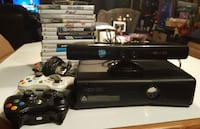black Xbox 360 console with controller and game ca