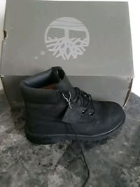 2 pairs of shoes 1Blk swuade Timberlands/2 NIKE AIR 1s