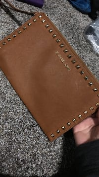 brown leather Michael Kors wristlet 1954 km