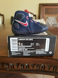 unpaired of blue and red Lebron XIII shoe on box Coachella, 92236
