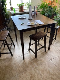 Wooden pub table with 4 stools