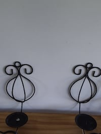 7 black rod iron candle holders   3 sets of 2 and 1 extra for inside or outside New Dundee