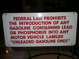 VINTAGE GASOLINE METAL SIGN 19 INCHES LONG 9 INCHE