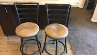 two brown leather padded bar stools Fort Collins, 80528