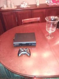 black Xbox 360 game console with controller AUSTIN