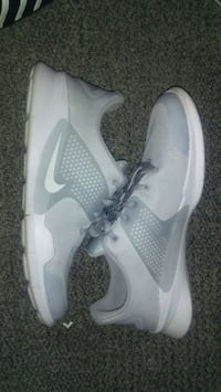 pair of white Nike running shoes Vancouver, V6J