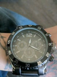 round black chronograph watch with black strap Calgary, T2A 5R6