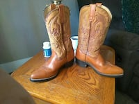 pair of brown leather cowboy boots Springfield, 65803