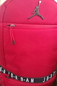 red and black leather backpack Langley