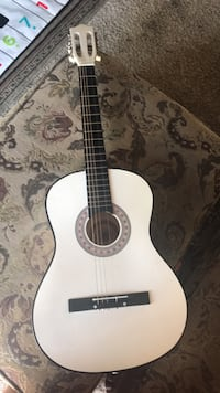 white and black classical guitar Fremont, 94536