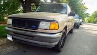 white Ford single cab pickup truck