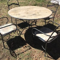 Round black wrought iron table and chairs antique