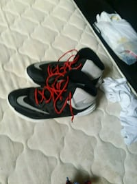 pair of black-and-red Nike basketball shoes Lincoln, 68505